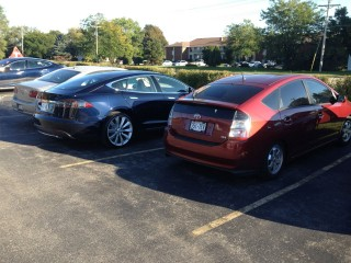 Our Prius next to a Model S.