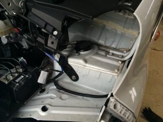 Empty socket where headlight was.