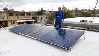 Jomel installing solar panels